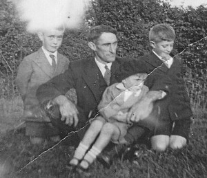 My grandad with his three sons, Tom, Frank, and my father, Joe.
