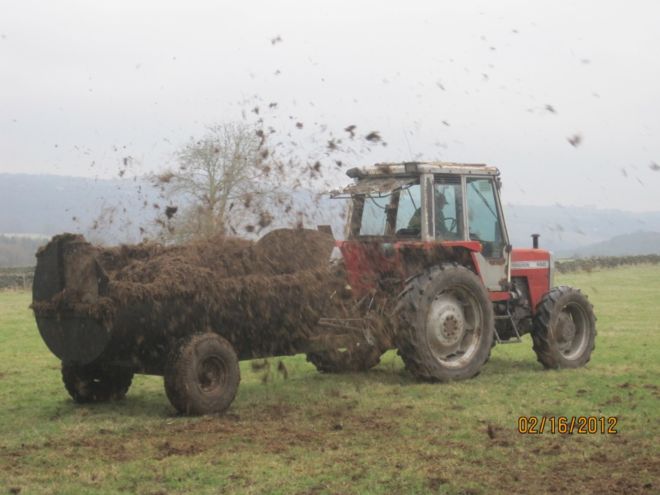 Frank muck-spreading on the farm.