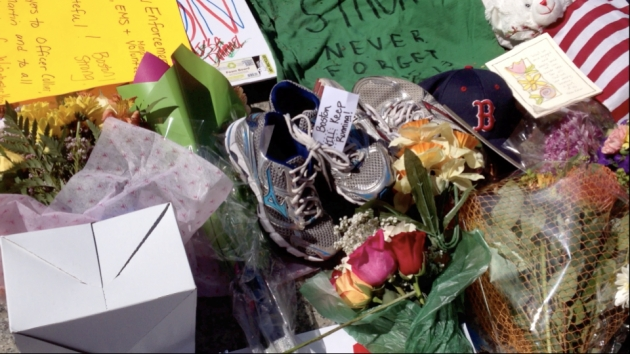 Running shoes at the Boston Marathon memorial.  Copyright Virginia A Smith