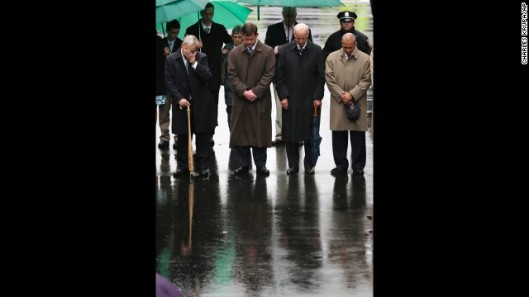 Former Boston Mayor Tom Menino, Boston Mayor Martin Walsh, Vice President Joe Biden and Mass. Gov. Deval Patrick lower their heads for a moment of silence during a tribute in honor of the one year anniversary of the Boston Marathon bombings, Tuesday, April 15, 2014 in Boston. (AP Photo/Charles Krupa)