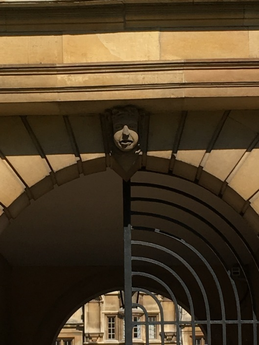 Gargoyle over a College gate.